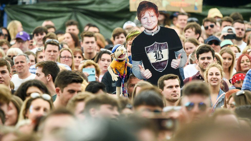 An Ed Sheeran cardboard cut-out in the crowd as he performs during the first day of BBC Music's Biggest Weekend at Singleton Park