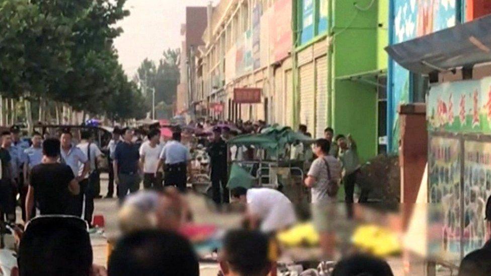 Crowd outside nursery in eastern China