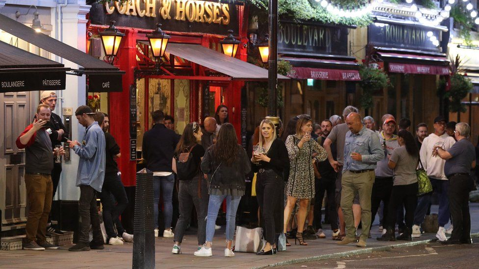 People outside the Coach and Horses pub in Wellington Street, London.