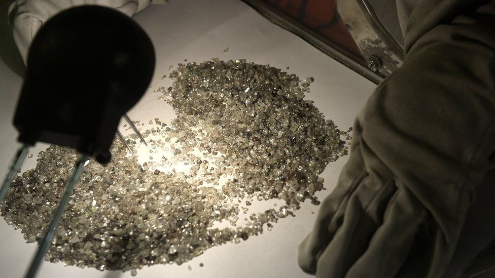 Pile of rough diamonds on a table