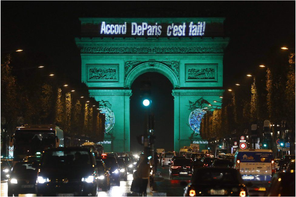 "This file photo taken on November 4 2016 shows The Arc de Triomphe illuminated with the words ""The Paris accord is done"" in Paris, to celebrate the first day of the application of the Paris climate accord"