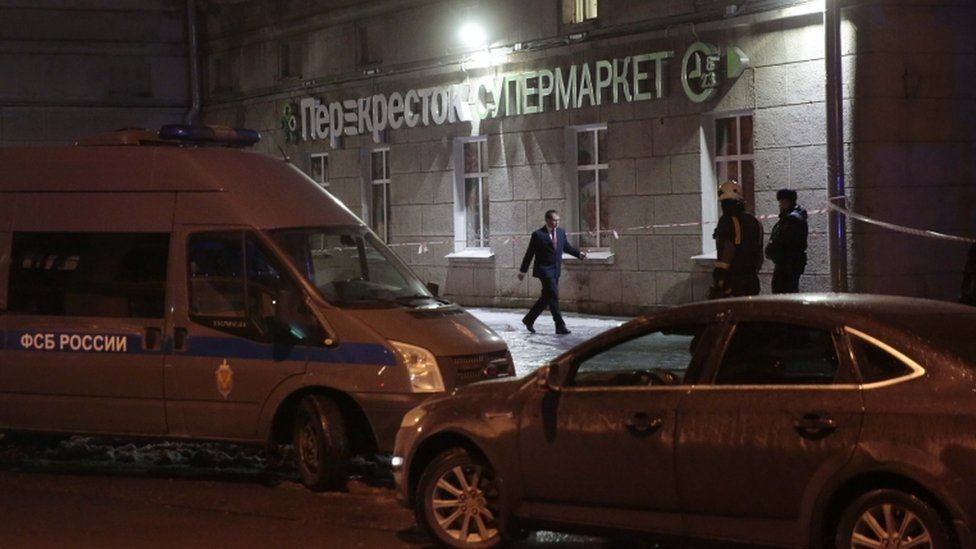 A vehicle (left) of the Russian Federal Security Service (FSB) is parked near a supermarket after an explosion in St Petersburg, Russia, 27 December 2017.