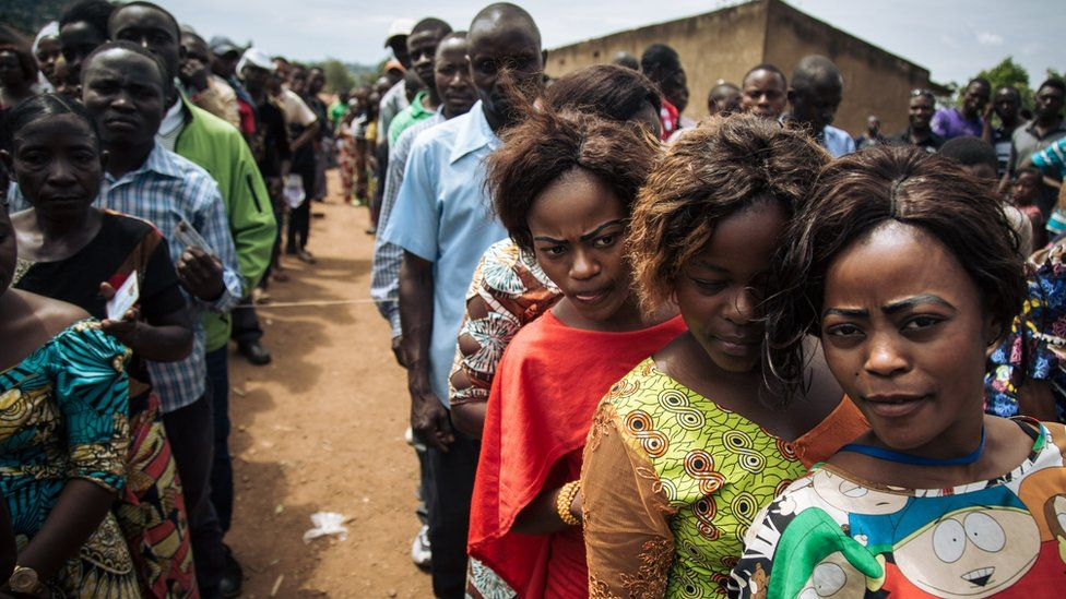 Voters queue to cast their ballots at a symbolic polling station on December 30, 2018, at Malepe Stadium in Beni,