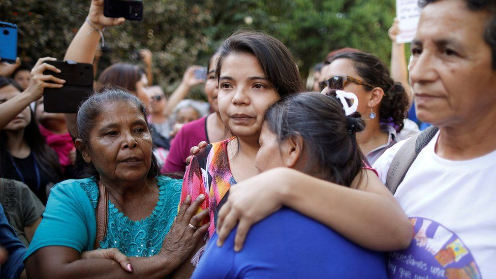 Imelda Cortez reacts as she leaves a court of law after being acquitted of attempted aggravated murder under the country's abortion law, in Usulutan, El Salvador