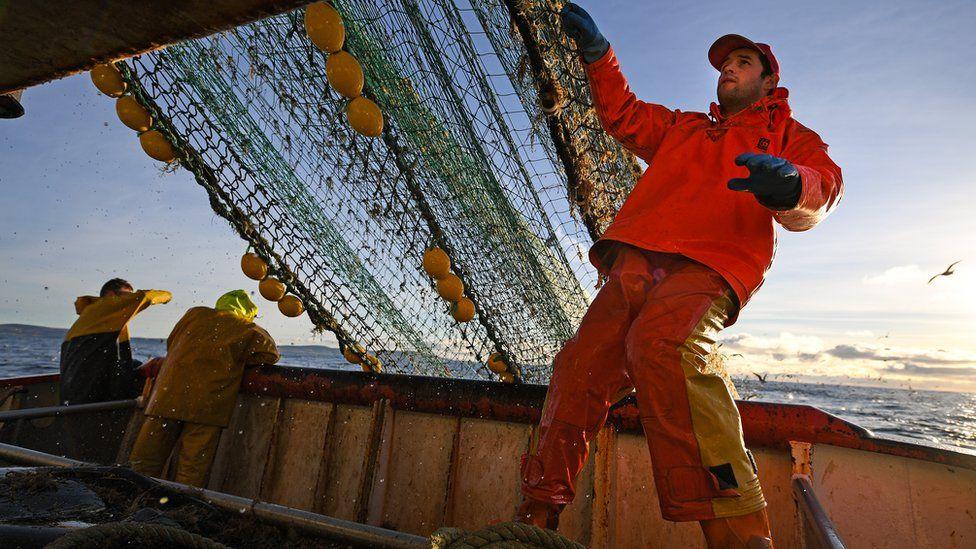 A fisherman on a trawler off the coast of Scotland