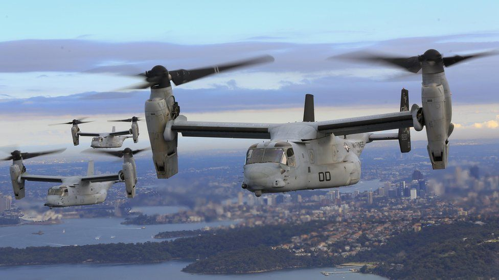 Three MV-22 Osprey aircraft flying in formation above the Pacific Ocean off the coast of Sydney, Australia, on 29 June