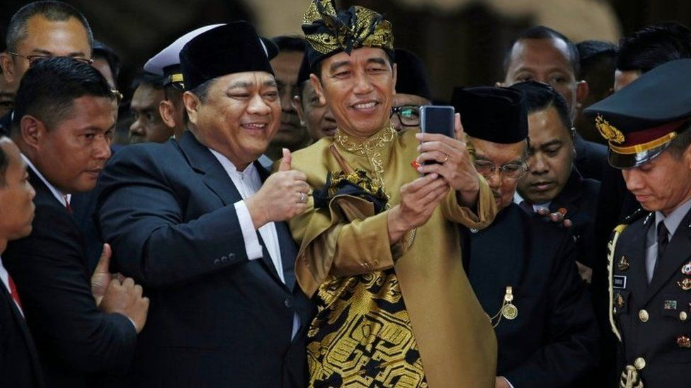Mr Widodo poses for a selfie with a member of parliament in August