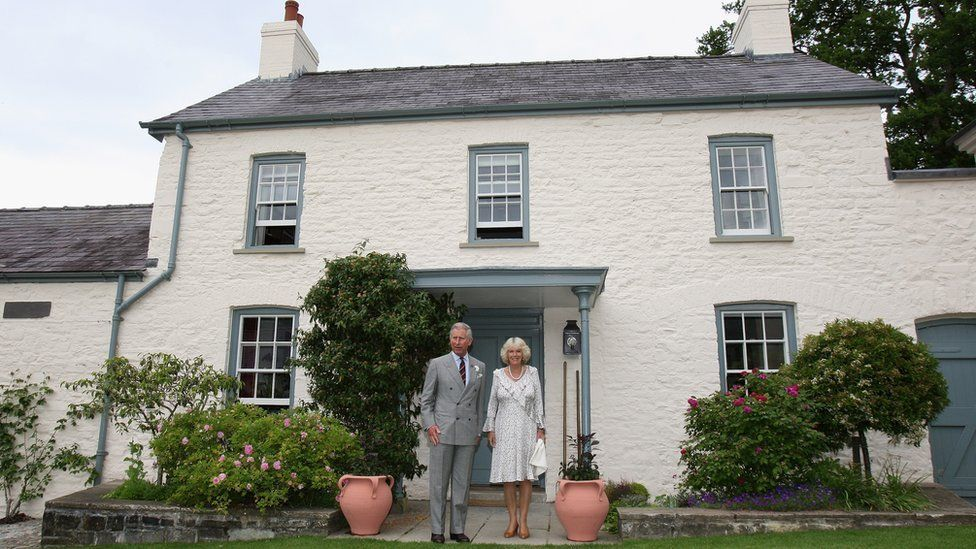 Prince Charles and the Duchess of Cornwall outside Llwynywermod in 2009
