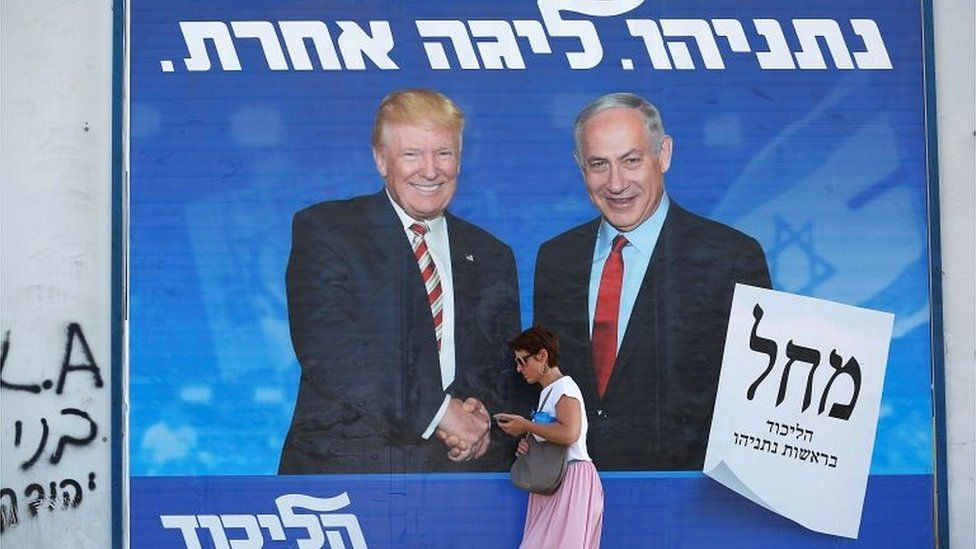 A woman walks past a Likud party election campaign banner showing US President Donald Trump and Israeli Prime Minister Benjamin Netanyahu in Tel Aviv, Israel, on 16 September 2019