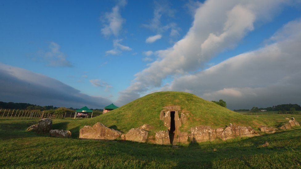 Bryn Celli Ddu Burial Chamber under a blue sky