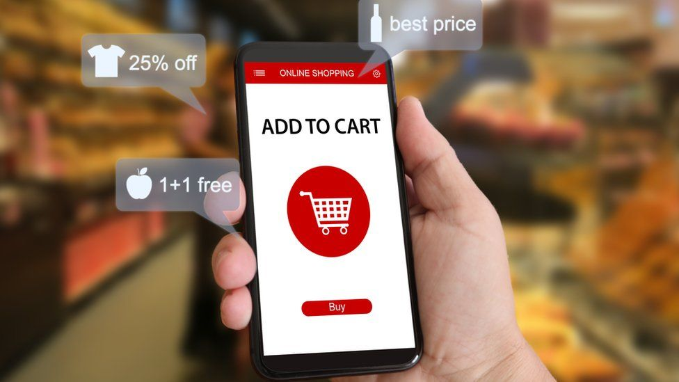 Smartphone showing shopping basket in graphics