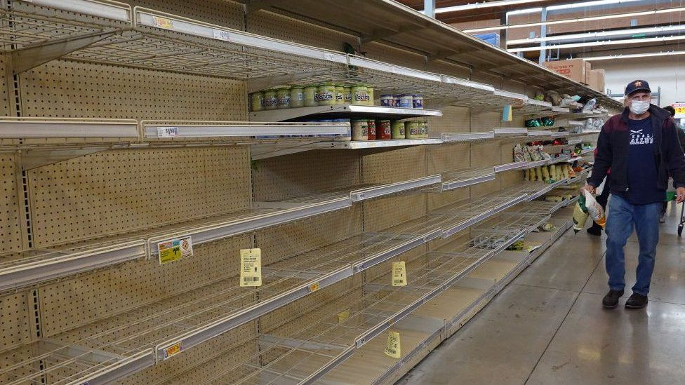 Shelves are empty of bottled water