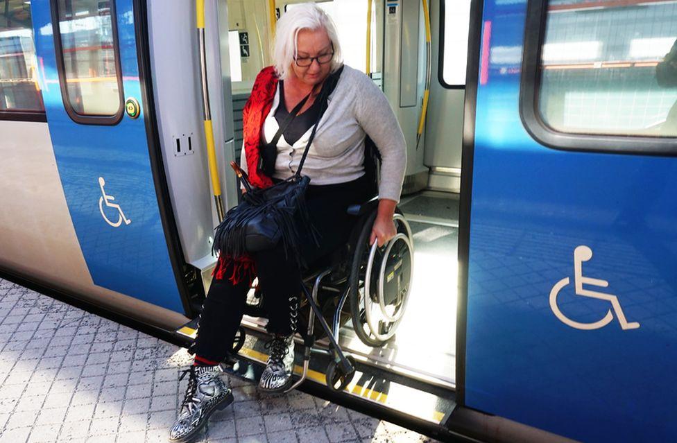 Carina Wellton exiting a train
