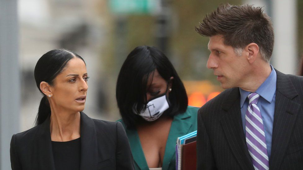 R Kelly's defence attorney Nicole Blank Becker and Thomas Farinella arrive at the court