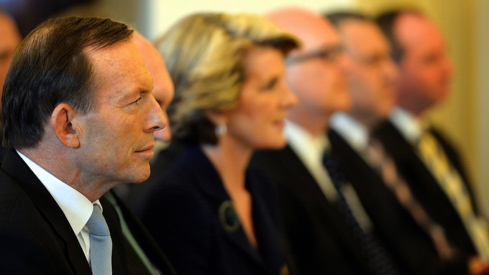 Tony Abbott (L) sits with his cabinet ministers during a swearing-in ceremony at Government House in Canberra in September 2013