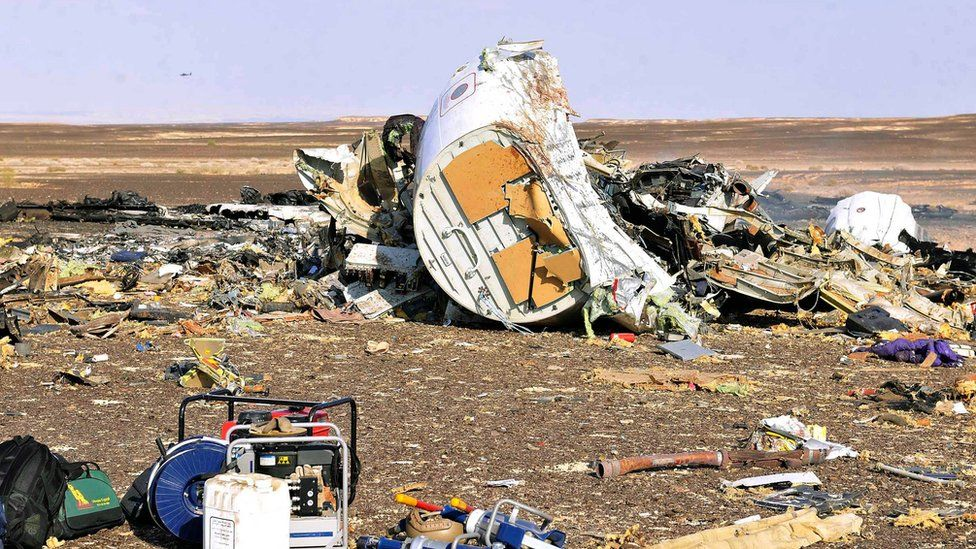 Debris from crashed Russian jet lies strewn across the sand at the site of the crash, Sinai, Egypt, 31 October 2015.