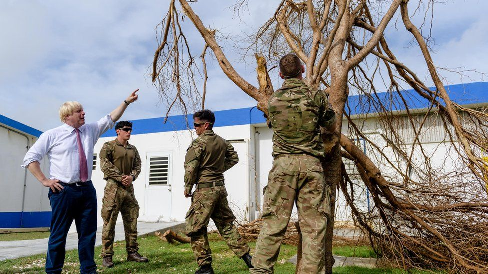 Boris Johnson talks to Royal Engineers as they remove a tree destroyed by Hurricane Irma