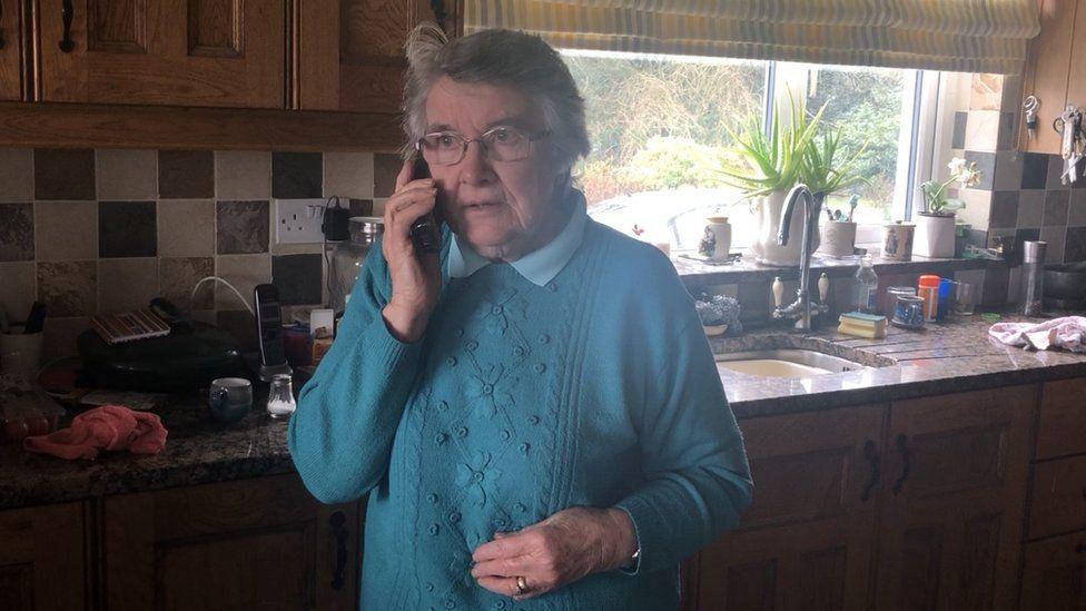 Rebecca talking on the phone