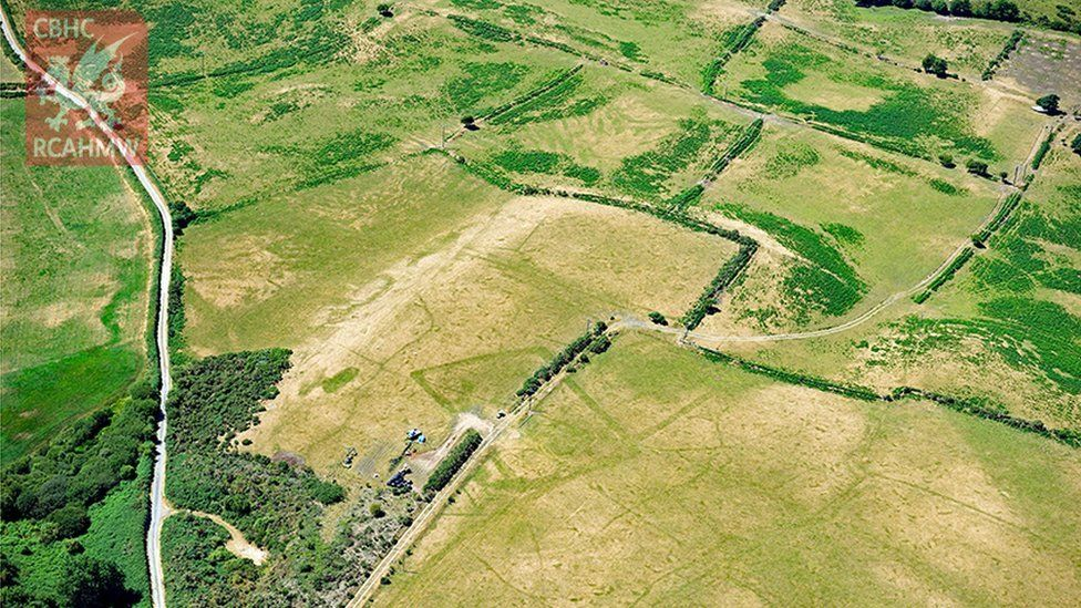 Prehistoric enclosures seen among the pastureland and fields
