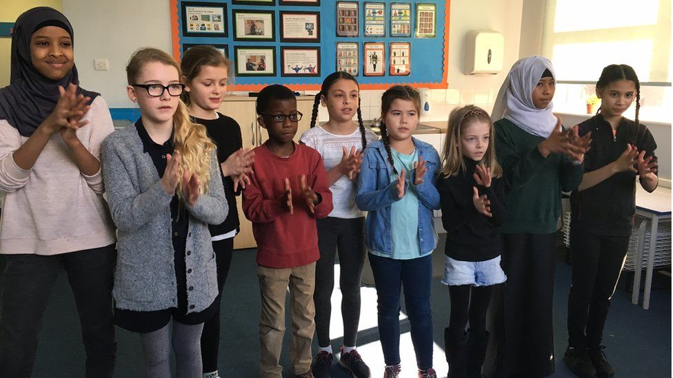 deaf and hearing children signing together