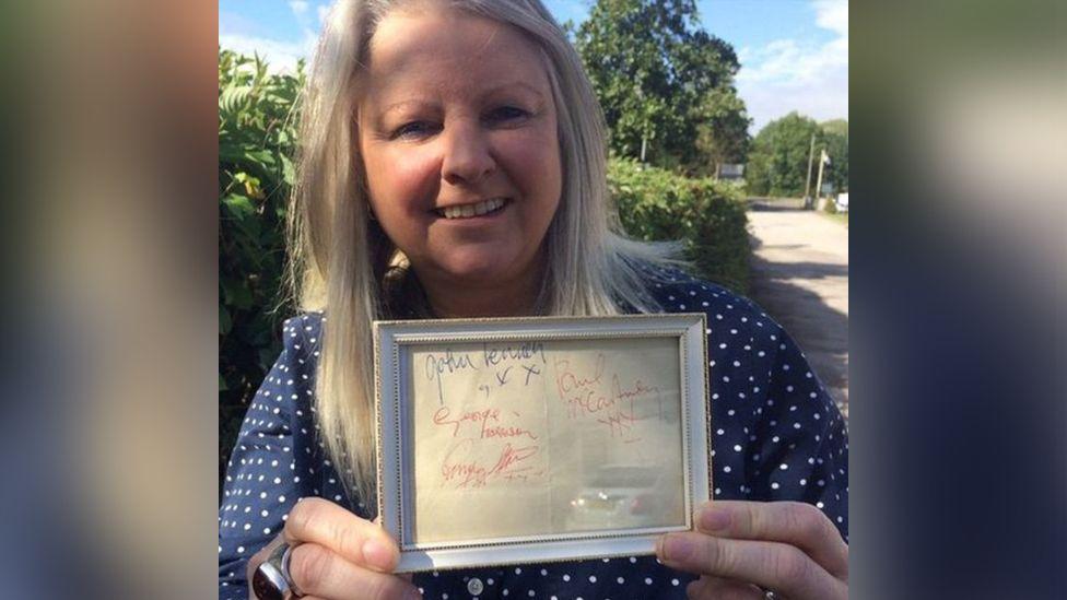 Hansons' music memorabilia specialist Claire Howell with the signatures