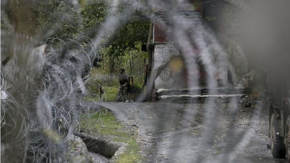 An Indian army soldier keeps vigil at his post by a military base at Braripora, near the de facto border dividing Kashmir between India and Pakistan, in Indian controlled Kashmir