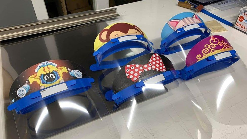 Protective face visors decorated with cartoons