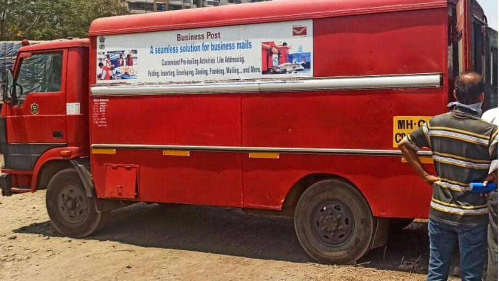 A red postal van