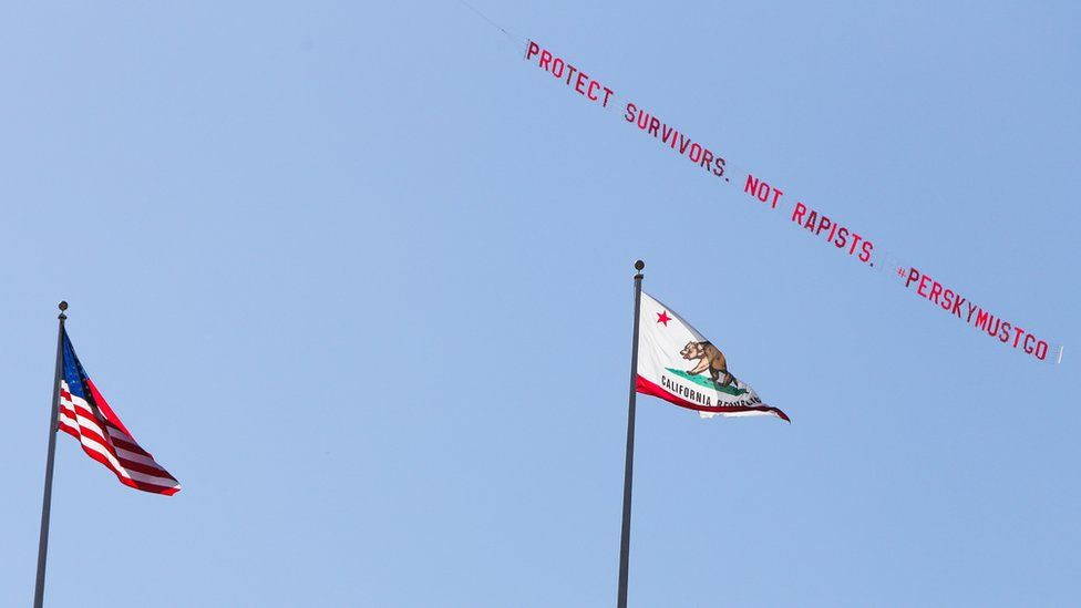 A plane flies over Stanford University with a banner reading 'Protect Survivors. Not Rapists. #PerskyMustGo'