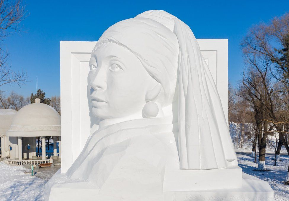 An ice sculpture of the painting Girl with a Pearl Earring by Johannes Vermeer