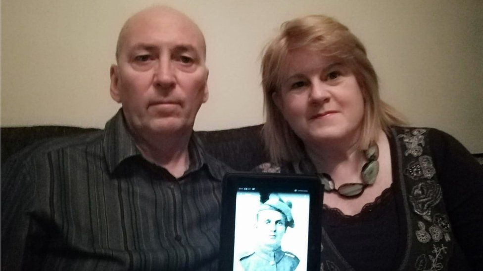 john and jane with photo of Andrew Webb