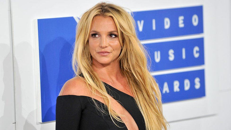 Radio waves are dominated by Britney Spears' music as DJs indicate unity.