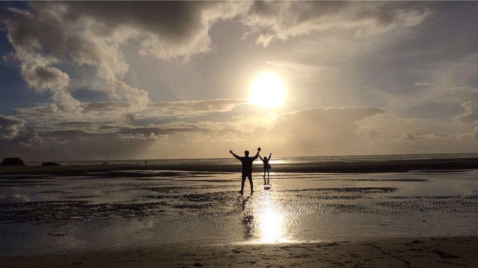 Oscar and Eden Goldman on the beach at Mawgan Porth
