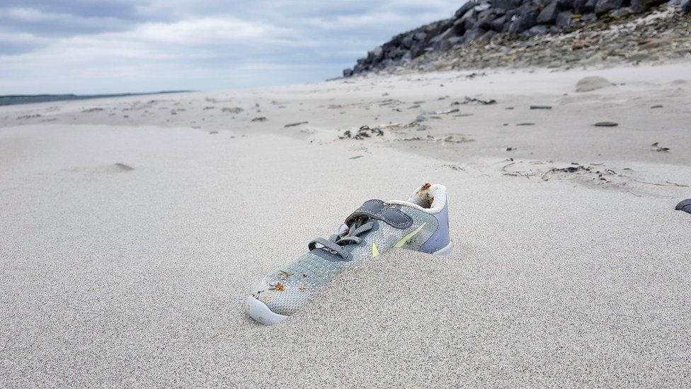e22086774f9 Why are Nike trainers washing up on beaches? - BBC News