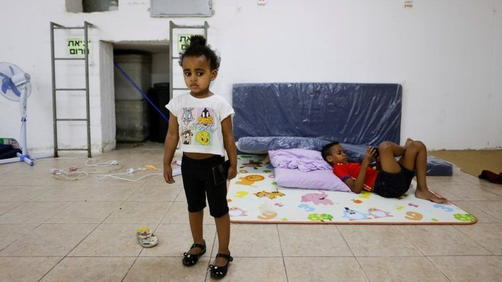 Children are seen inside a bomb shelter in Ashkelon, southern Israel
