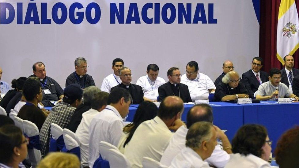 """General view of """"national dialogue"""" talks among government's representatives, Nicaragua's Roman Catholic bishops and the opposition as an attempt to stifle anti-government riots, in Managua on June 15, 2018."""