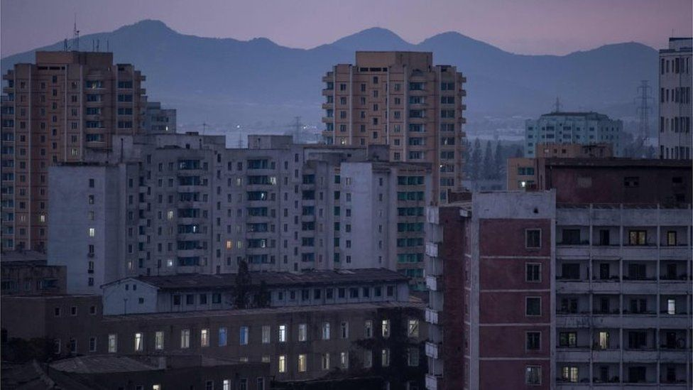 A general view shows apartment buildings and the city skyline of Pyongyang on September 22, 2017.