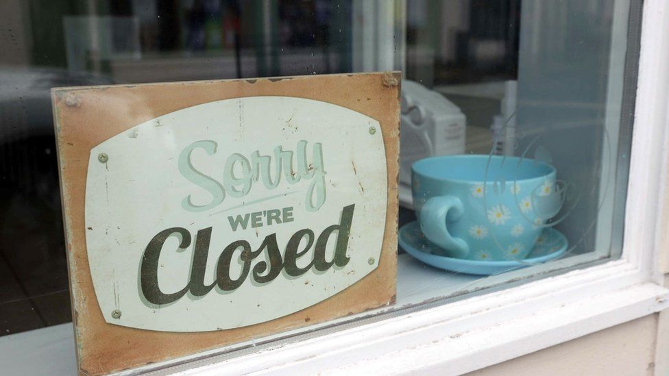 """""""Sorry We're Closed"""" sign in a shop window in Ballycastle, County Antrim"""