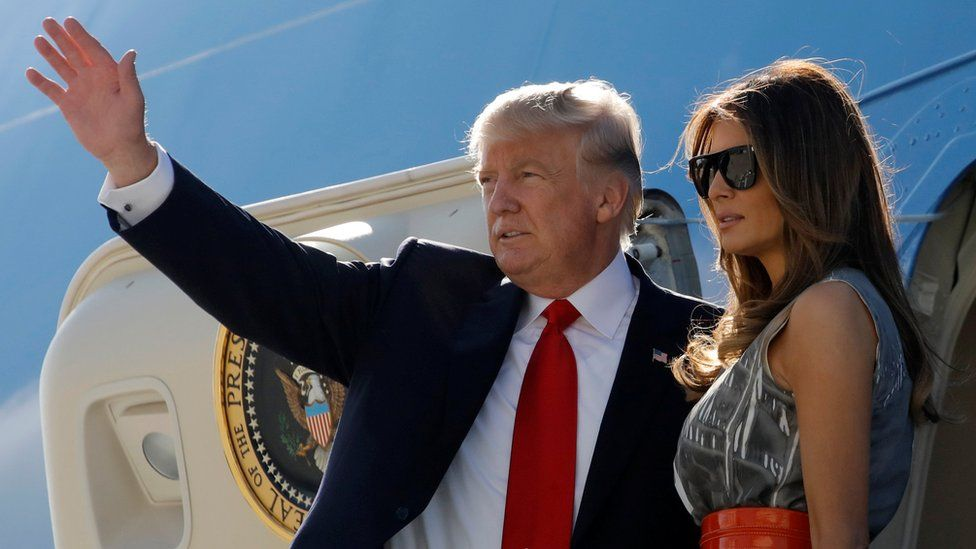 US President Donald Trump and first lady Melania Trump board Air Force One as they depart Hamburg, Germany, for Washington, 8 July 2017