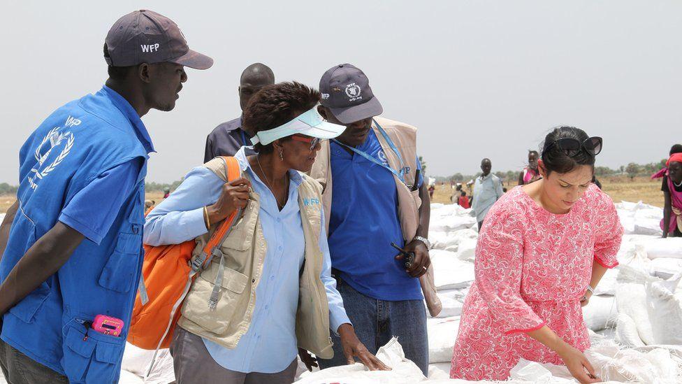 The UK's international development secretary, Priti Patel, inspecting aid sacks