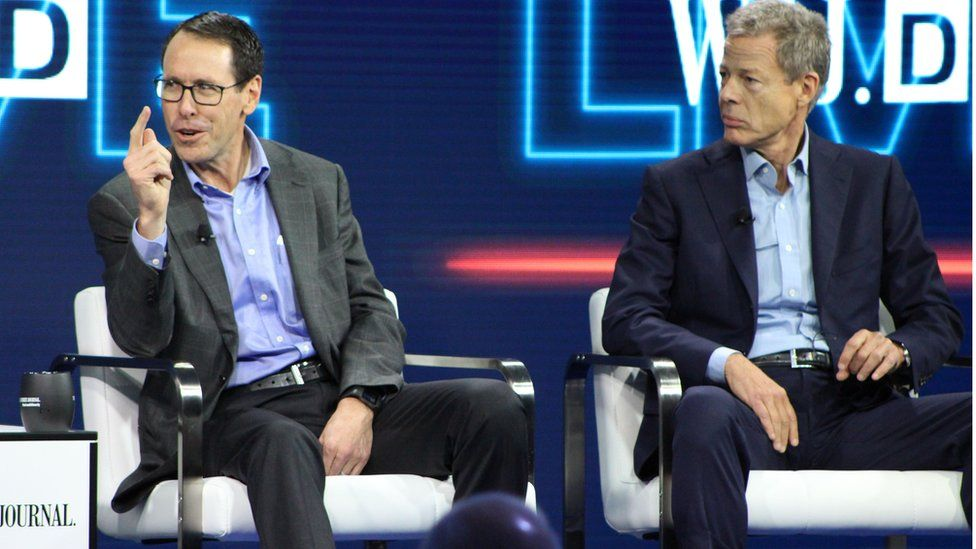 AT&T chief executive Randall Stephenson (L) and Time Warner chief executive Jeffrey Bewkes (R) defend the proposed mega-merger of the companies at a WSJD Live technology conference in Laguna Beach, California, on October 25, 2016.