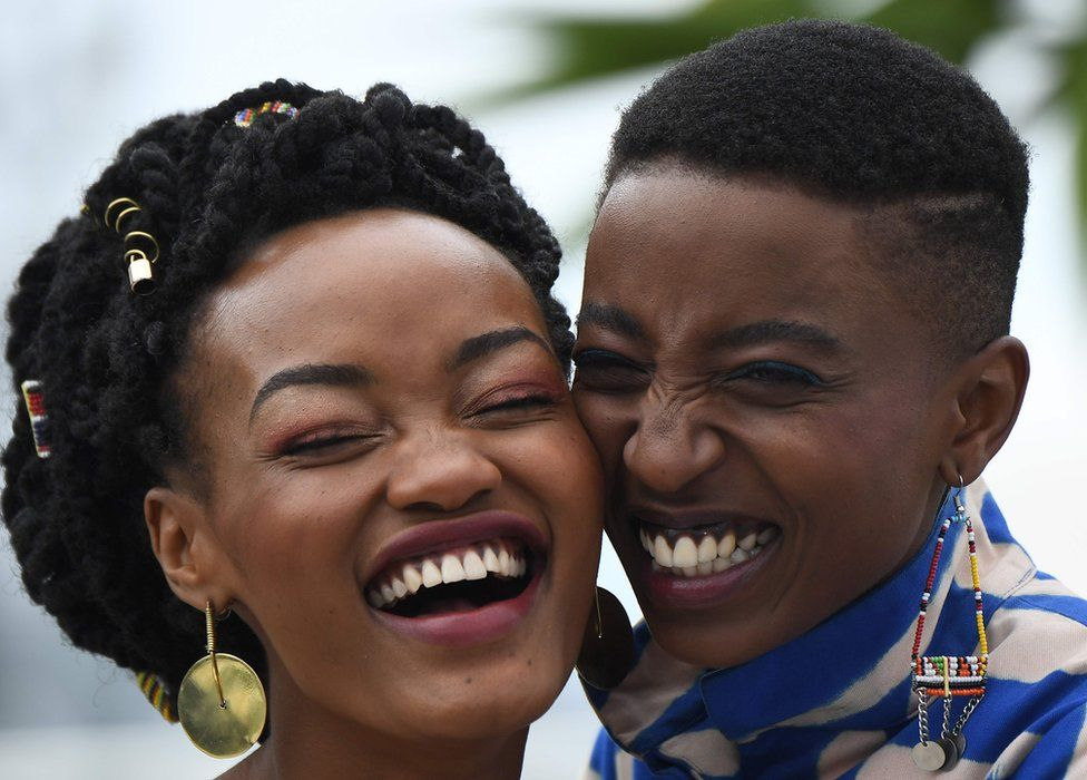 """Kenyan actress Sheila Munyiva (L) and Kenyan actress Samantha Mugatsia pose on May 9, 2018 during a photocall for the film """"Rafiki"""" during the 71st edition of the Cannes Film Festival in Cannes, southern France"""