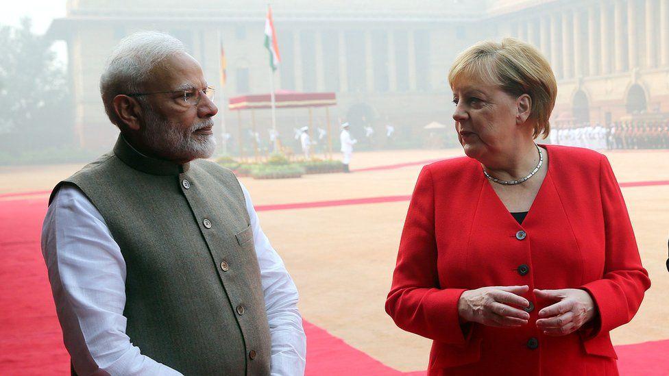 Indian Prime Minister Narendra Modi (L) and Chancellor of Germany Angela Merkel (R) talk at Rashtrapati Bhavan, India's presidential palace in Delhi, India, 01 November 2019