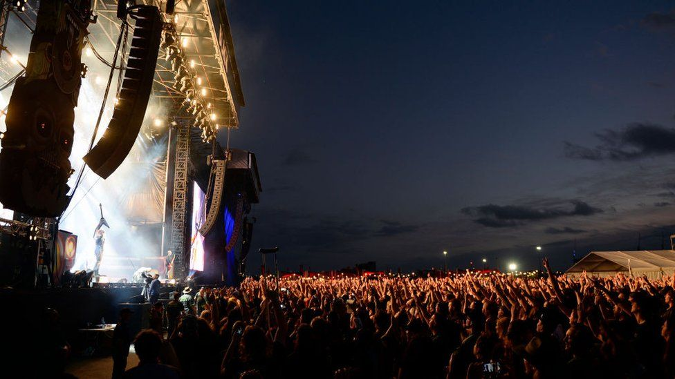 A wide view of a stage and crowd at a music festival in Melbourne