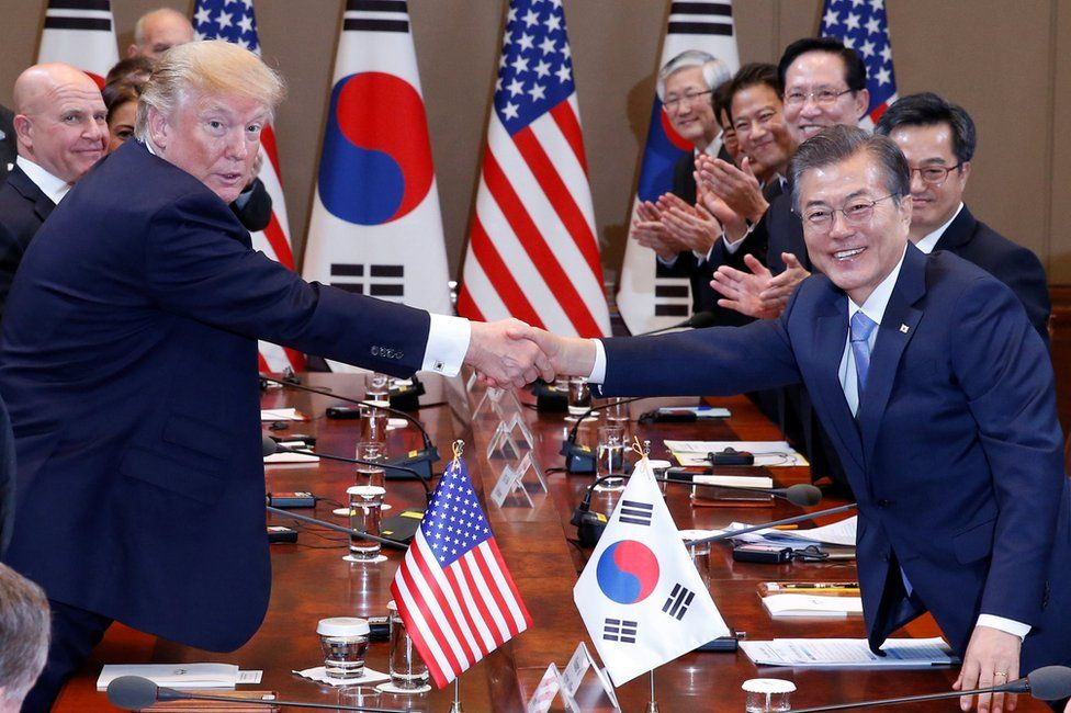 U.S. President Donald Trump and South Korea's President Moon Jae-in shake hands before the summit meeting at the Presidential Blue House in Seoul, South Korea, November 7, 2017.