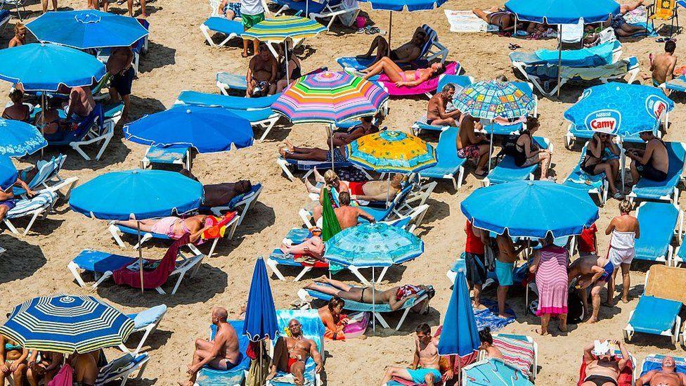 Tourists on a beach