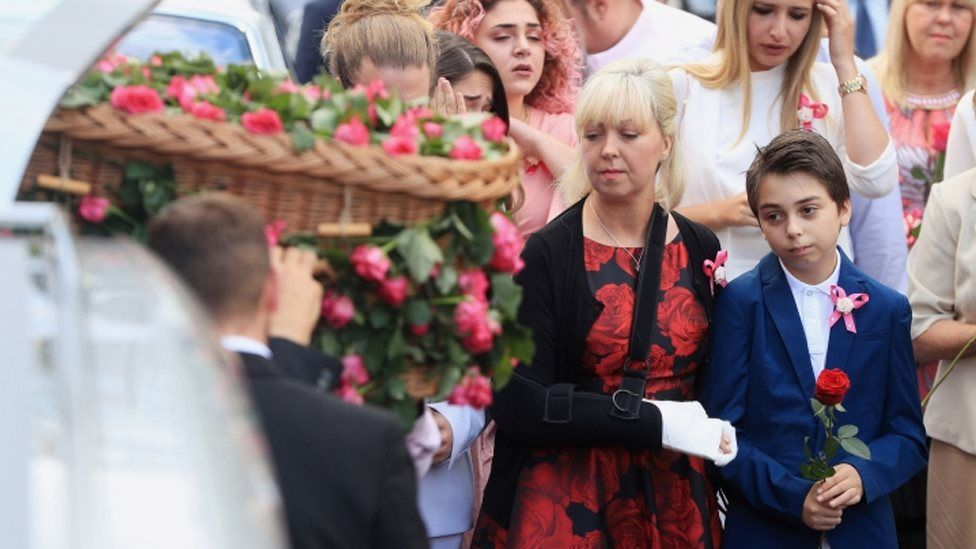 Mother Lisa Roussos and brother Xander with the coffin of Saffie Roussos