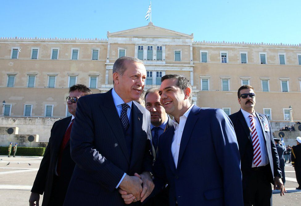 Turkey's President Tayyip Erdogan shakes hands with Greek Prime Minister Alexis Tsipras in Athens