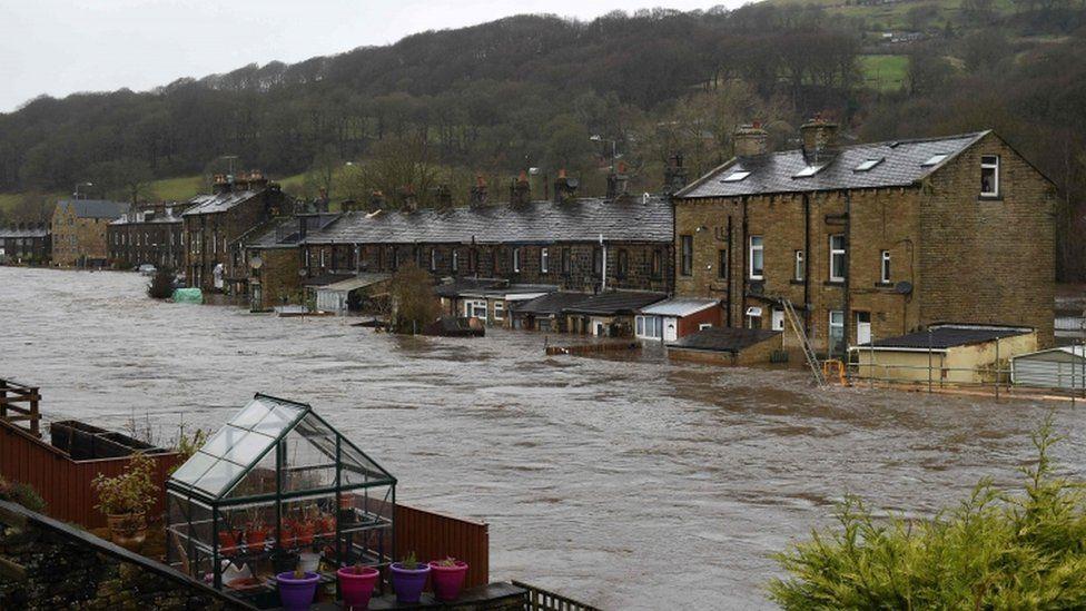 Flooded houses in Mytholmroyd, northern England, after the River Calder burst its banks