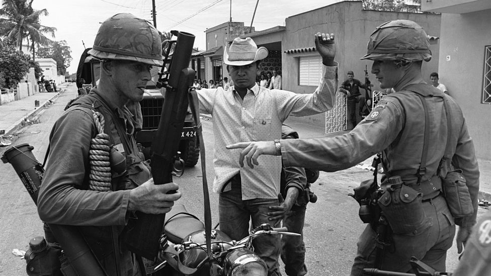 US Army Airborne troops search a suspect during the occupation of the Dominican Republic in 1965.
